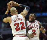 Chicago Bulls' Taj Gibson (22) and Nate Robinson (2) celebrate a basket against the Brooklyn Nets during the second overtime in Game 4 of their first-round NBA basketball playoff series Saturday, April 27, 2013, in Chicago. The Bulls won 142-134 in three overtimes. (AP Photo/Jim Prisching)