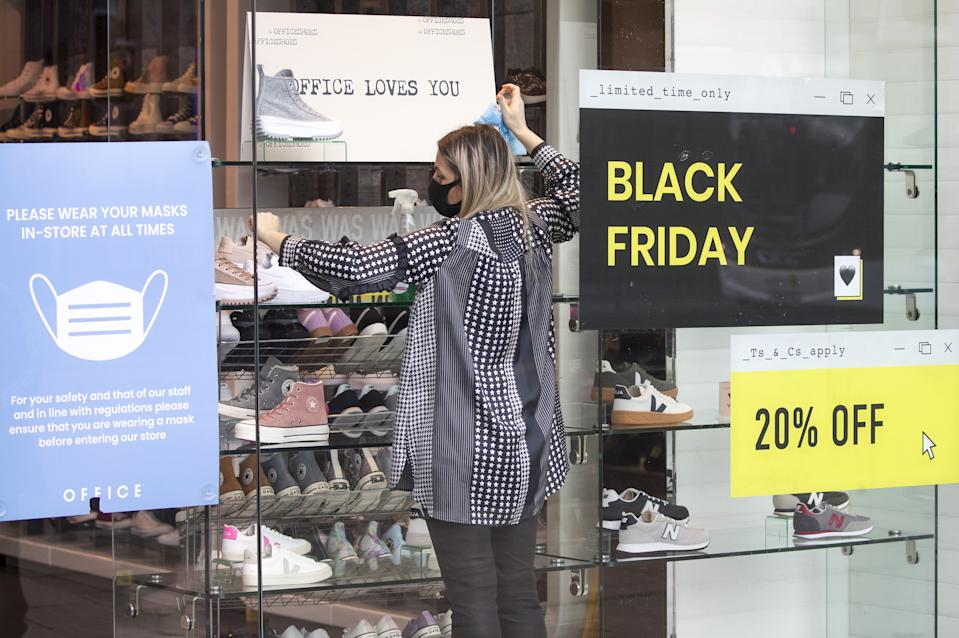 Shops along Princes Street in Edinburgh display posters and signs advertising sales ahead of Black Friday. (Photo by Jane Barlow/PA Images via Getty Images)