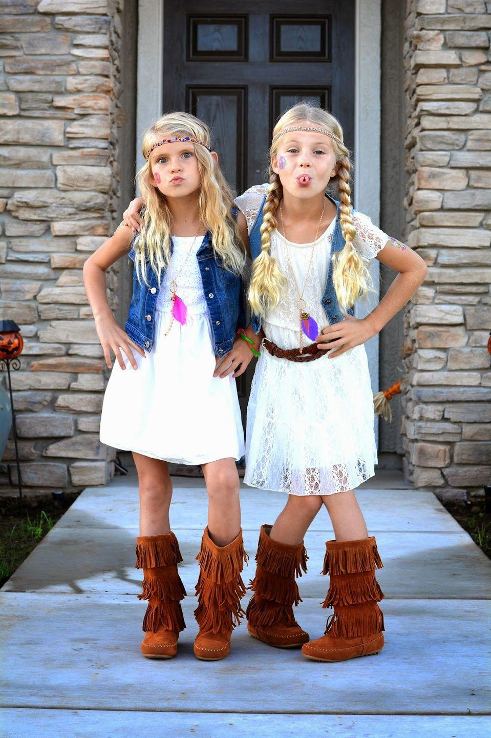 "<p>This DIY will work for kids and adults alike! If you have a boho-style white dress and a denim vest, you're pretty much halfway there. Just add some fringe boots and layer on some necklaces and a headband and you're ready for <a href=""https://www.countryliving.com/life/kids-pets/a23932768/what-time-does-trick-or-treating-start/"" rel=""nofollow noopener"" target=""_blank"" data-ylk=""slk:trick-or-treating"" class=""link rapid-noclick-resp"">trick-or-treating</a>.</p><p><strong>Get the tutorial at <a href=""http://minifashionaddicts.blogspot.com/2014/10/hippie-day.html"" rel=""nofollow noopener"" target=""_blank"" data-ylk=""slk:Mini Fashion Addicts"" class=""link rapid-noclick-resp"">Mini Fashion Addicts</a>. </strong></p><p><a class=""link rapid-noclick-resp"" href=""https://www.amazon.com/Milumia-Womens-Bohemian-Drawstring-Splicing/dp/B01GCE2FGE/ref=sr_1_4?tag=syn-yahoo-20&ascsubtag=%5Bartid%7C10050.g.28305469%5Bsrc%7Cyahoo-us"" rel=""nofollow noopener"" target=""_blank"" data-ylk=""slk:SHOP WHITE DRESSES"">SHOP WHITE DRESSES</a><br></p>"