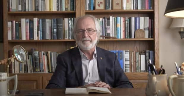 In a video statement issued Monday, Queen's University principal Patrick Deane pledged the university will reassess its screening process for evaluating claims of Indigenous identity. (Queen's University/YouTube - image credit)