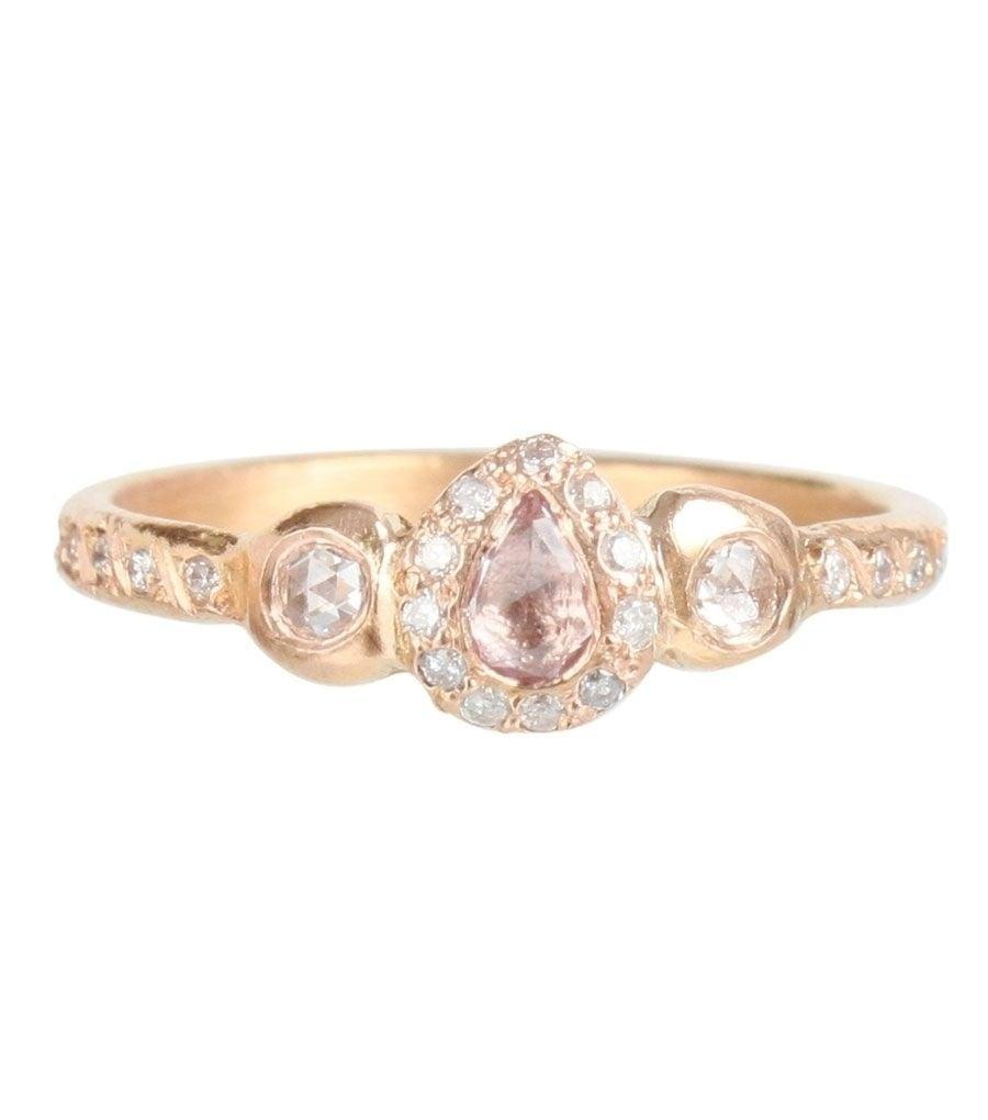 """<p>Between the diamond encrusted band and .25 carat rose cut pink sapphire, we're in love with the <a href=""""https://www.popsugar.com/buy/Pavlova-Pink-Sapphire-Ring-530026?p_name=Pavlova%20Pink%20Sapphire%20Ring&retailer=catbirdnyc.com&pid=530026&price=2%2C318&evar1=fab%3Aus&evar9=44555978&evar98=https%3A%2F%2Fwww.popsugar.com%2Fphoto-gallery%2F44555978%2Fimage%2F47001599%2FPavlova-Pink-Sapphire-Ring&list1=wedding%2Cjewelry%2Crose%20gold%2Cengagement%20rings&prop13=api&pdata=1"""" rel=""""nofollow noopener"""" class=""""link rapid-noclick-resp"""" target=""""_blank"""" data-ylk=""""slk:Pavlova Pink Sapphire Ring"""">Pavlova Pink Sapphire Ring</a> ($2,318). </p>"""