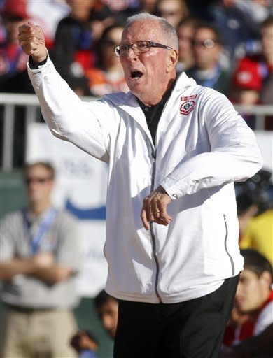 San Diego State coach Steve Fisher directs his team during the second half of their 62-49 loss to Syracuse in an NCAA college basketball game on the deck of the USS Midway, Sunday, Nov. 11, 2012, in San Diego. (AP Photo/Lenny Ignelzi)