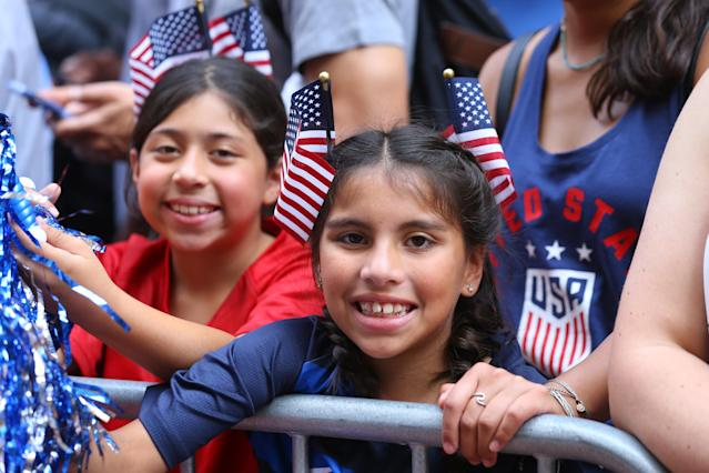 Fans celebrate as members of the the U.S. women's soccer team pass by during a ticker tape parade along the Canyon of Heroes, Wednesday, July 10, 2019, in New York. (Photo: Gordon Donovan/Yahoo News)