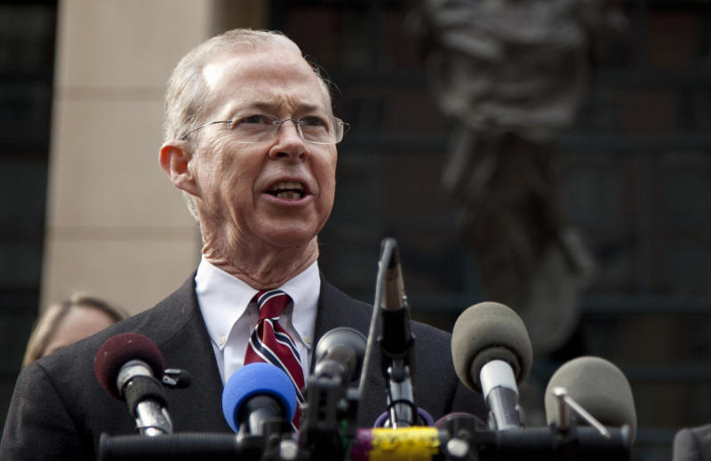 FILE - In this Jan. 26, 2012 file photo, Dana Boente, then First Assistant U.S. Attorney for the Eastern District of Virginia, speaks outside federal court in Alexandria, Va. Boenete, an understated career federal prosecutor, has found himself at the epicenter of several of the Trump administration's biggest controversies. (AP Photo/Evan Vucci, File)