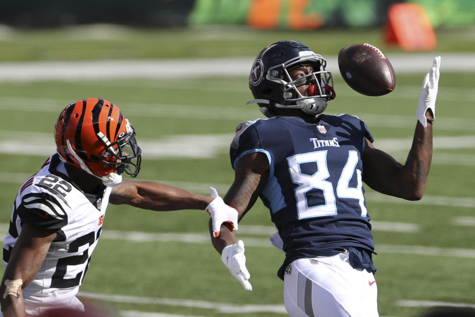 Tennessee Titans' Corey Davis (84) is defended by Cincinnati Bengals' William Jackson (22) in last week's loss. (AP Photo/Jay LaPrete)