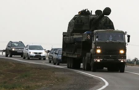 Russian military truck loaded with Msta-S self-propelled howitzer drives along the road outside Kamensk-Shakhtinsky, Rostov region, August 19, 2014. REUTERS/Alexander Demianchuk