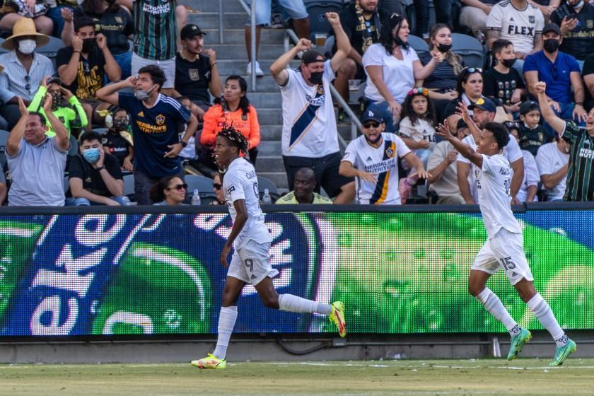 The Galaxy's Kévin Cabral, left, celebrates his game-tying goal against LAFC at Banc of California Stadium on Aug. 28, 2021.