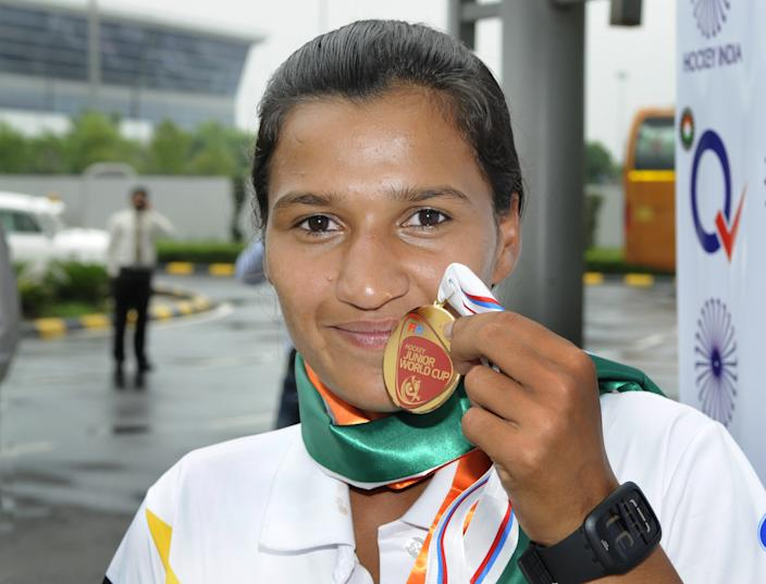 NEW DELHI, INDIA - AUGUST 6: Rani Rampal, star player of Indian Women's Junior Hockey team which won bronze medal at Junior Hockey World Cup showing her bronze medal after arrival at the Indira Gandhi International Airport on August 6, 2013 in New Delhi, India. Indian girls scripted history at the seventh FIH Junior World Cup in Monchengladbach, Germany by beating England 3-2 in a penalty shootout in bronze medal play-off match on August 4 to finish on the podium.(Photo by Sushil Kumar/Hindustan Times via Getty Images)