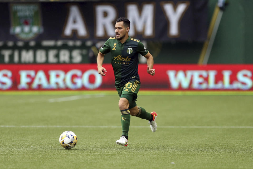 Portland Timbers midfielder Sebastian Blanco pushes the ball ahead during an MLS soccer match against Los Angeles FC, Sunday, Sept. 19, 2021, in Portland, Ore. (Sean Meagher/The Oregonian via AP)