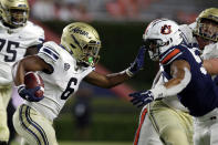 Akron running back Jonzell Norrils (6) stiff-arms Auburn defensive end Eku Leota (55) during the second half of an NCAA college football game Saturday, Sept. 4, 2021, in Auburn, Ala. (AP Photo/Butch Dill)