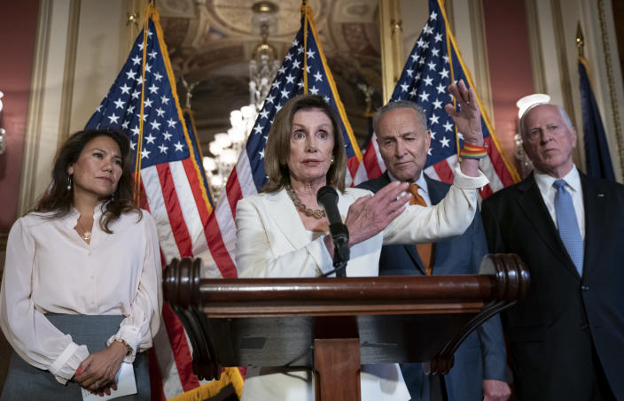 From left, Rep. Veronica Escobar, D-Texas, whose district contains El Paso, Texas, where a gunman killed 22 people at an El Paso, Texas, Walmart, Speaker of the House Nancy Pelosi, D-Calif., Senate Minority Leader Chuck Schumer, D-N.Y., and Rep. Mike Thompson, D-Calif., chairman of the House Gun Violence Prevention Task Force, call for a Senate vote on the House-passed Bipartisan Background Checks Act as Congress returns for the fall session with pressure mounting on Senate Majority Leader Mitch McConnell to address gun violence, at the Capitol in Washington, Monday, Sept. 9, 2019. (AP Photo/J. Scott Applewhite)
