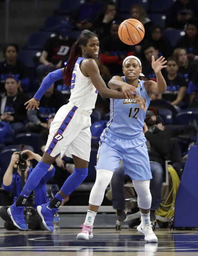 DePaul's Chante Stonewall (22) knocks away a pass intended for Marquettes' Erika Davenport (12) during the first half of an NCAA college basketball game in the championship of the Big East conference tournament, Tuesday, March 6, 2018, in Chicago. (AP Photo/Charles Rex Arbogast)