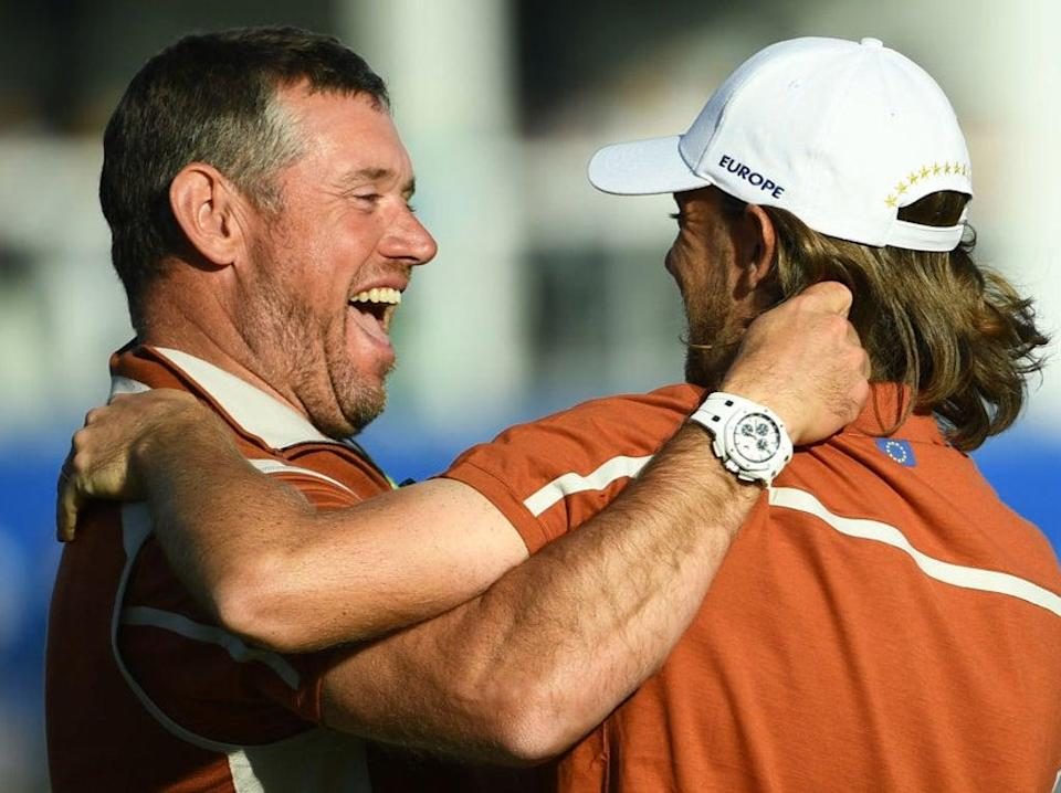 Team Europe vice-captain Lee Westwood celebrates with Tommy Fleetwood in 2018 (AFP via Getty Images)