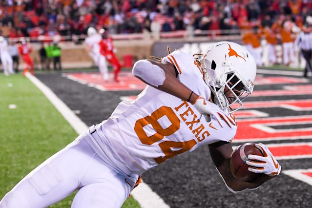 LUBBOCK, TX – NOVEMBER 10: Lil'Jordan Humphrey #84 of the Texas Longhorns falls across the goal line and scores the winning touchdown with seconds left in the fourth quarter against the Texas Tech. (Photo by John Weast/Getty Images)