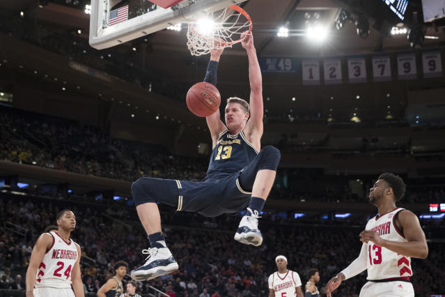 "Michigan forward <a class=""link rapid-noclick-resp"" href=""/ncaab/players/131251/"" data-ylk=""slk:Moritz Wagner"">Moritz Wagner</a>, of Germany, dunks during the first half of an NCAA college basketball game against Nebraska in the quarterfinals of the Big Ten conference tournament, Friday, March 2, 2018, at Madison Square Garden in New York. (AP Photo/Mary Altaffer)"