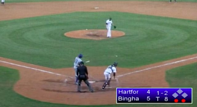 The ball is in the grass, but the batter is mid-swing. (Screenshot via @Cut4)