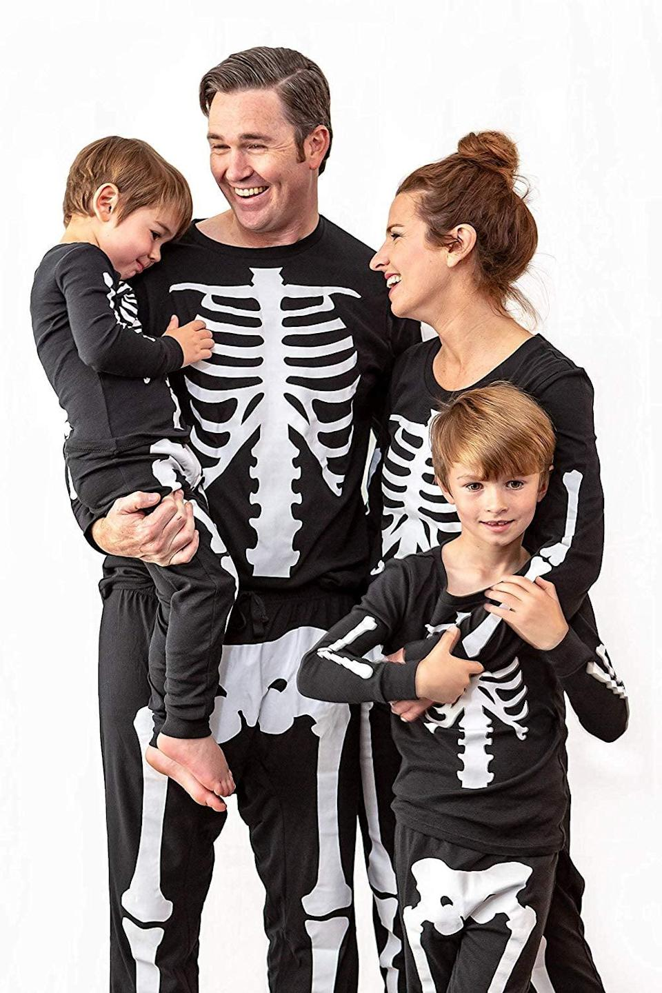 <p>These <span>Under Disguise Family Matching Halloween Pajama Sets</span> ($25) can also double as a skeleton costume.</p>