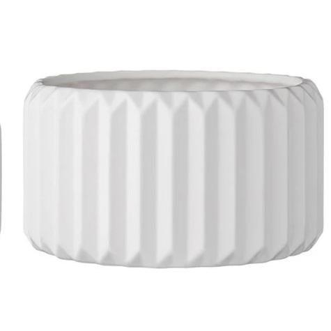 "<p>This <a href=""https://www.popsugar.com/buy/White-Textured-Planter-582481?p_name=White%20Textured%20Planter&retailer=effortlesscomposition.com&pid=582481&price=40&evar1=casa%3Aus&evar9=47553754&evar98=https%3A%2F%2Fwww.popsugar.com%2Fhome%2Fphoto-gallery%2F47553754%2Fimage%2F47553847%2FWhite-Textured-Planter&list1=shopping%2Chome%20decorating%2Chome%20shopping&prop13=api&pdata=1"" class=""link rapid-noclick-resp"" rel=""nofollow noopener"" target=""_blank"" data-ylk=""slk:White Textured Planter"">White Textured Planter</a> ($40) would look great with an aloe plant or fern planted inside.</p>"