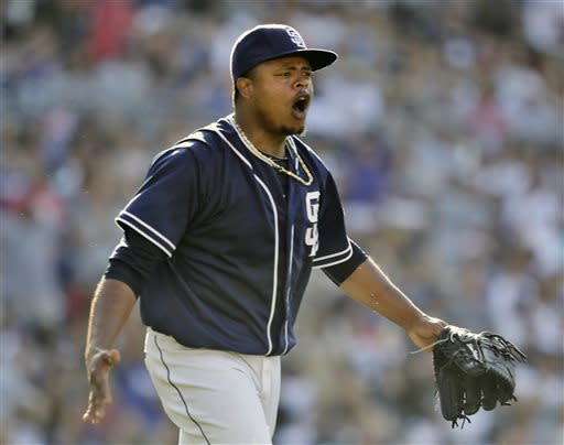 San Diego Padres starting pitcher Edinson Volquez reacts to a safe call by first base umpire Marty Foster on a would-be inning-ending double play against the Los Angeles Dodgers during the fifth inning of a baseball game in San Diego, Saturday, June 22, 2013. The Dodgers scored a run on the play. (AP Photo/Lenny Ignelzi)