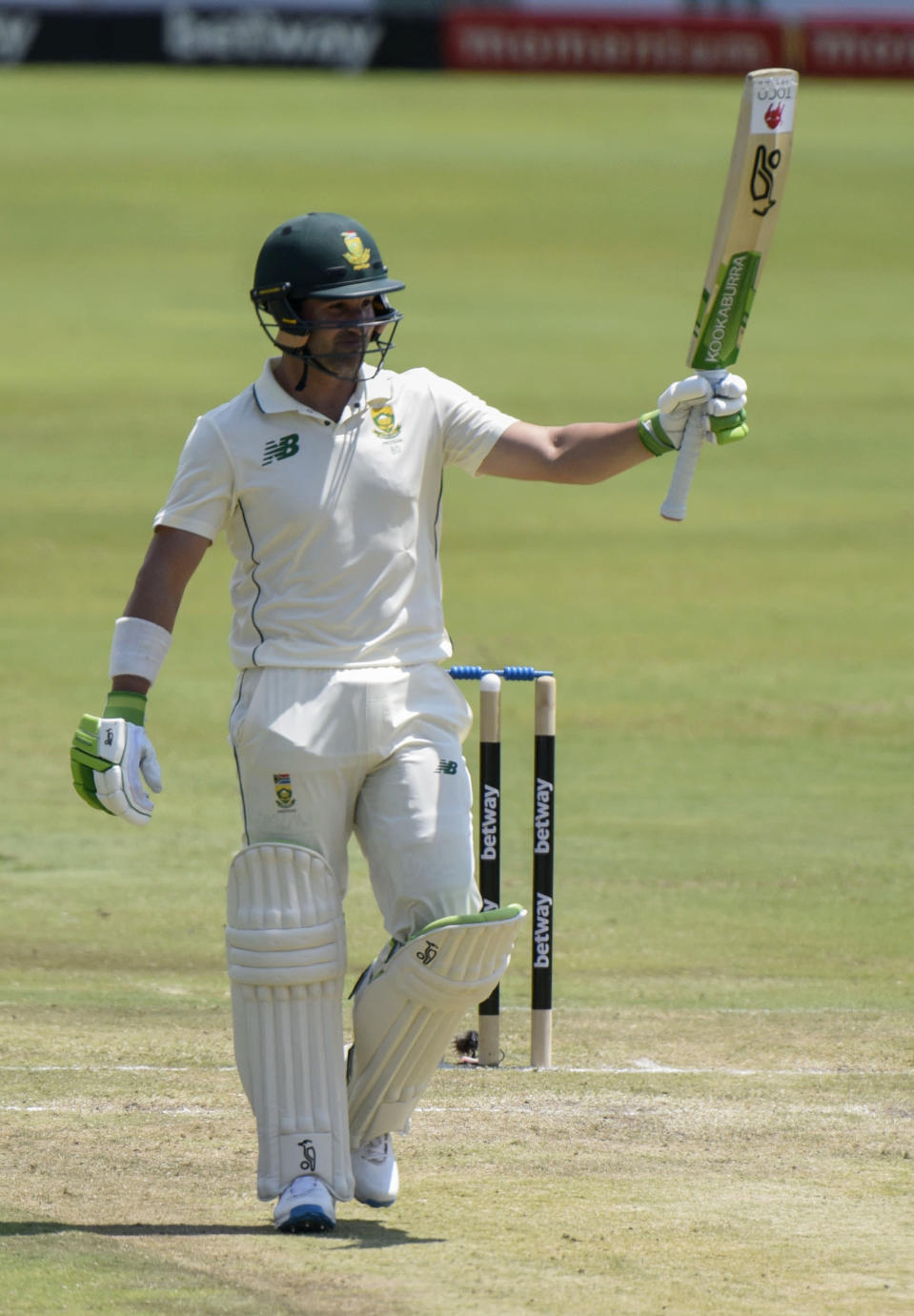 South Africa's Dean Elgar celebrates a 50, on day two of the first cricket test match between South Africa and Sri Lanka at Super Sport Park Stadium in Pretoria, South Africa, Sunday, Dec. 27, 2020. (AP Photo/Catherine Kotze)