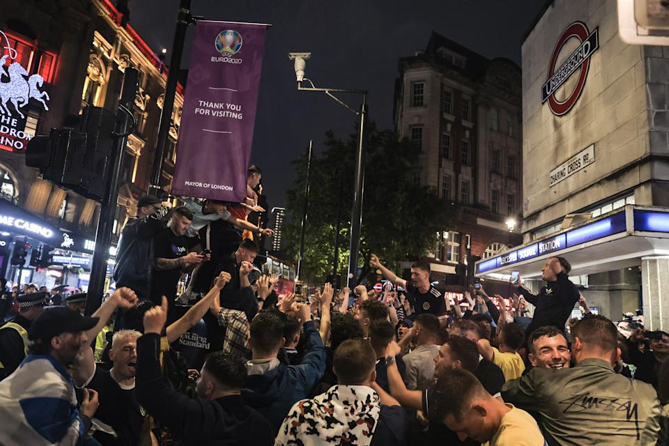 Crowd of happy Scotland supporters in Leicester Square after England drew with Scotland in UEFA. Scottish football fans gathering around central London after Scotland drew the UEFA game with England. Supporters are seen in various locations in London and most of them are heavily drunk. (Photo by Hesther Ng / SOPA Images/Sipa USA)