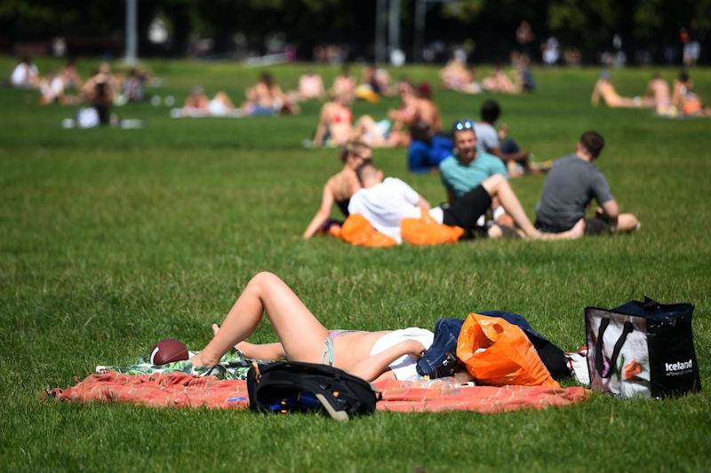 People enjoy the hot weather on Clapham Common (PA)