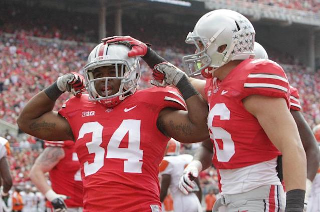 Ohio State running back Carlos Hyde, left, celebrates his touchdown against Florida A&M with teammate Jeff Heuerman during the first quarter of an NCAA college football game Saturday, Sept. 21, 2013, in Columbus, Ohio. (AP Photo/Jay LaPrete)