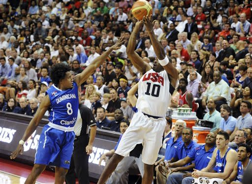 In this photo provided by the Las Vegas News Bureau, United States Olympic men's basketball team member Kobe Bryant (10) shoots a 3-pointer against the Dominican Republic during an exhibition game, Thursday, July 12, 2012, in Las Vegas. The U.S. won 113-59. (AP Photo/Las Vegas News Bureau, Brian Jones)