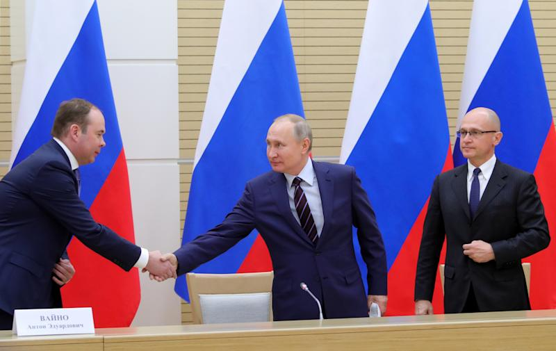 Russian President VladimirPutin shakes hands with Chief of Staff of the Presidential Executive Office Anton Vaino next to First Deputy Chief of Staff of the Presidential Office Sergei Kiriyenko before a meeting to prepare amendments to the Russian constitution at Novo-Ogaryovo state residence outside Moscow, Russia January 16, 2020. Sputnik/Mikhail Klimentyev/Kremlin via REUTERS ATTENTION EDITORS - THIS IMAGE WAS PROVIDED BY A THIRD PARTY.