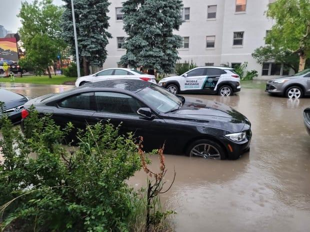 Roads were flooded in southwest Calgary as a severe thunderstorm rolled into the city on Friday. (Submitted by Bryn Welter - image credit)