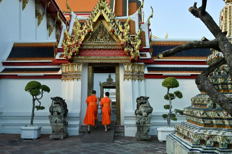 At Wat Pho's complex, trainees run through a catalogue of moves targeting the body's acupressure points with thumbs, elbows, knees and feet