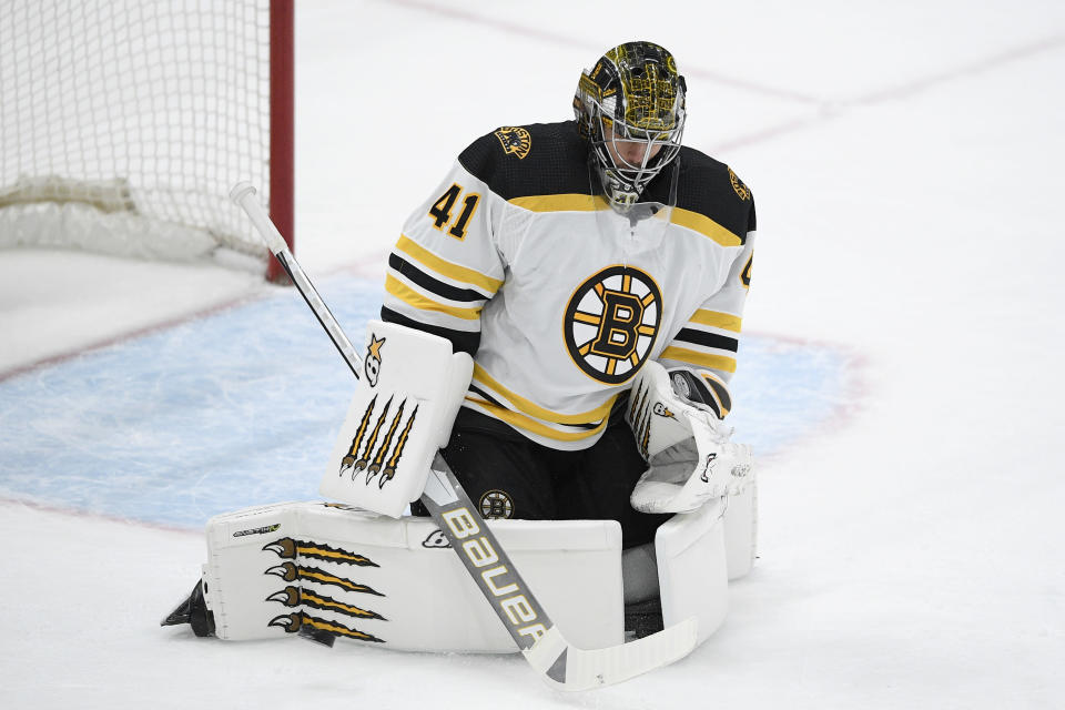 Boston Bruins goaltender Jaroslav Halak (41) stops the puck during the first period of an NHL hockey game against the Washington Capitals, Monday, Feb. 1, 2021, in Washington. (AP Photo/Nick Wass)