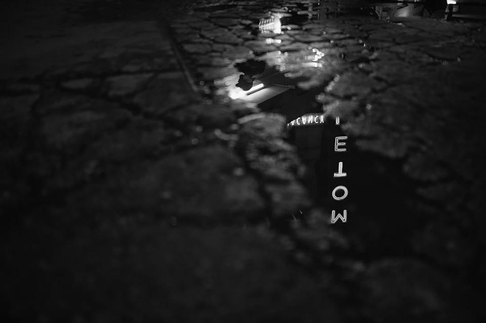 <p>This gritty, noir-ish shot of a motel sign reflected on the pavement sets a mood, and has fans searching for clues about the film, which takes place in the future. (Photo: wponx/Instagram) </p>