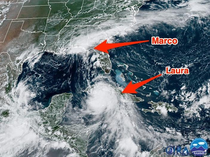 """Storms Marco and Laura are both churning in the Gulf of Mexico, as seen in this satellite image on August 24, 2020. <p class=""""copyright""""><a href=""""https://rammb-slider.cira.colostate.edu/?sat=goes-16&z=2&im=12&ts=1&st=0&et=0&speed=130&motion=loop&map=1&lat=0&opacity%5B0%5D=1&hidden%5B0%5D=0&pause=20200824191021&slider=-1&hide_controls=0&mouse_draw=0&follow_feature=0&follow_hide=0&s=rammb-slider&sec=full_disk&p%5B0%5D=geocolor&x=8192&y=5760"""" rel=""""nofollow noopener"""" target=""""_blank"""" data-ylk=""""slk:NOAA/CIRA/RAMMB"""" class=""""link rapid-noclick-resp"""">NOAA/CIRA/RAMMB</a></p>"""