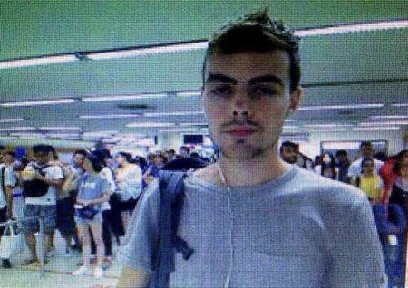 A suspect of a bank robbery in Singapore is seen in this airport picture in Bangkok