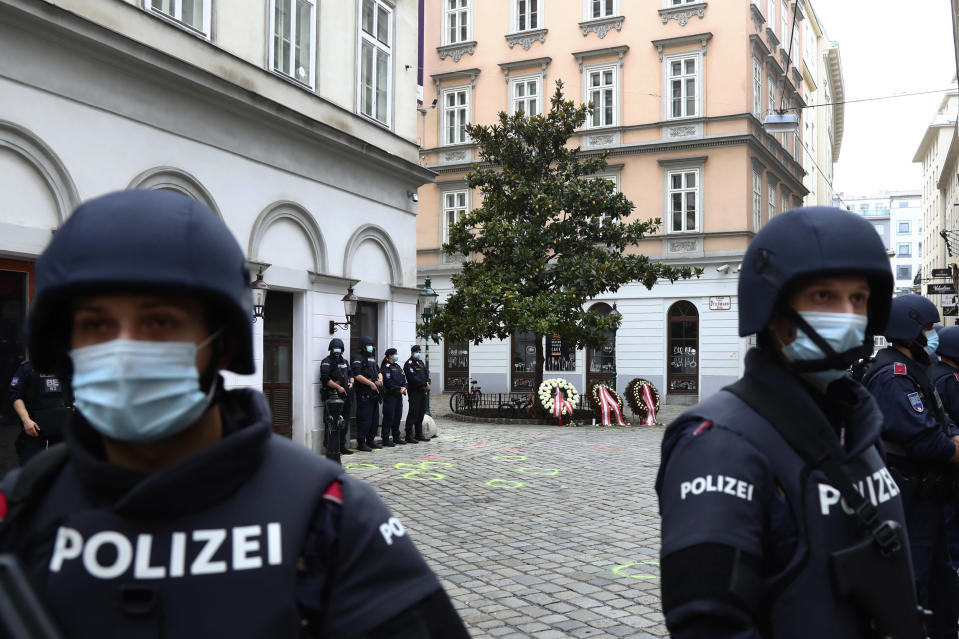 Police officers guard the scene in Vienna, Austria, Tuesday, Nov. 3, 2020. Police in the Austrian capital said several shots were fired shortly after 8 p.m. local time on Monday, Nov. 2, in a lively street in the city center of Vienna. Austria's top security official said authorities believe there were several gunmen involved and that a police operation was still ongoing. (AP Photo/Matthias Schrader)