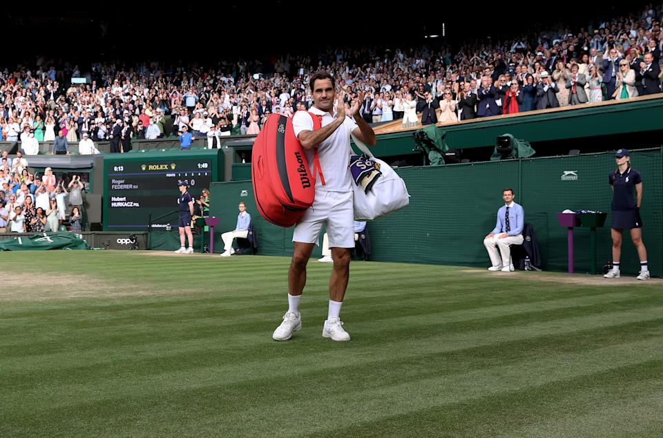 Roger Federer (pictured) thanks the crowd and walks off court after losing his men's Singles Quarter Final at Wimbledon.