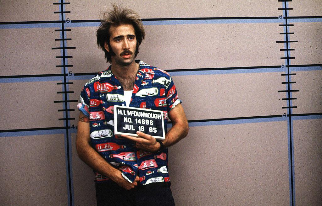 """<a href=""""http://movies.yahoo.com/movie/1800024145/info"""">RAISING ARIZONA</a> -- The Road Kill   Nic looks like a cross between a bingo hustler and a drowned cat in this early Coen brothers' opus."""