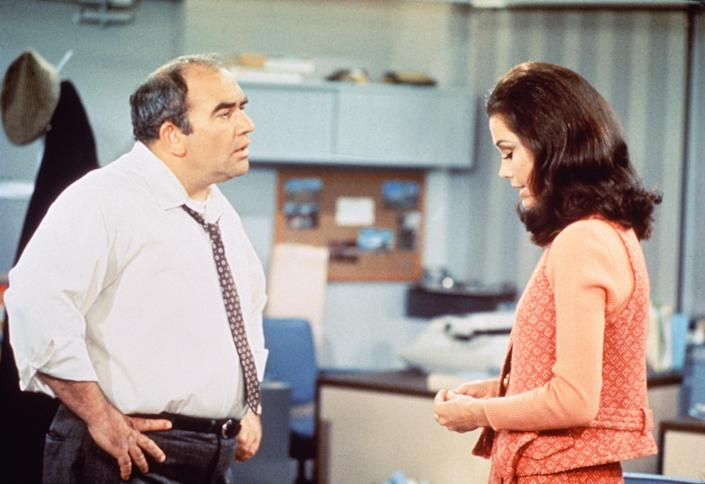 Ed Asner as Lou Grant and Mary Tyler Moore as Mary Richards in a scene from