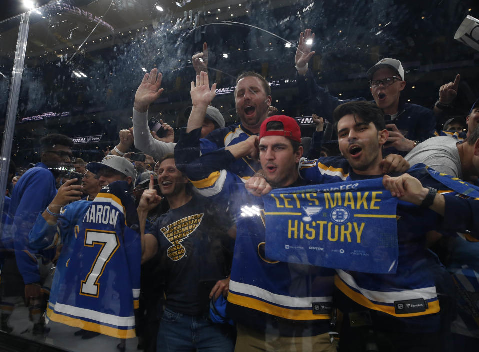 Jun 12, 2019; Boston, MA, USA; St. Louis Blues fans celebrate after their team defeated the Boston Bruins in game seven of the 2019 Stanley Cup Final at TD Garden. Mandatory Credit: Winslow Townson-USA TODAY Sports