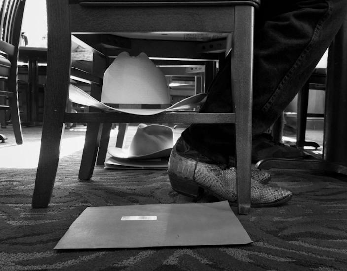<p>Montana delegates store their cowboy hats underneath their chairs during breakfast at Bob Evans. (Photo: Khue Bui for Yahoo News)</p>