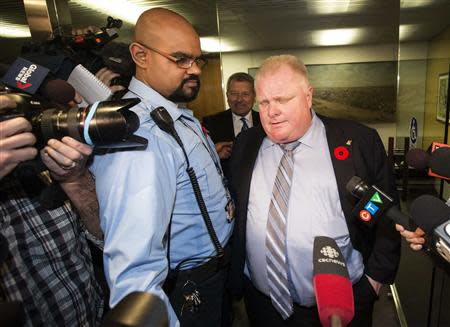 Toronto Mayor Ford reacts to a video released of him by local media at City Hall in Toronto