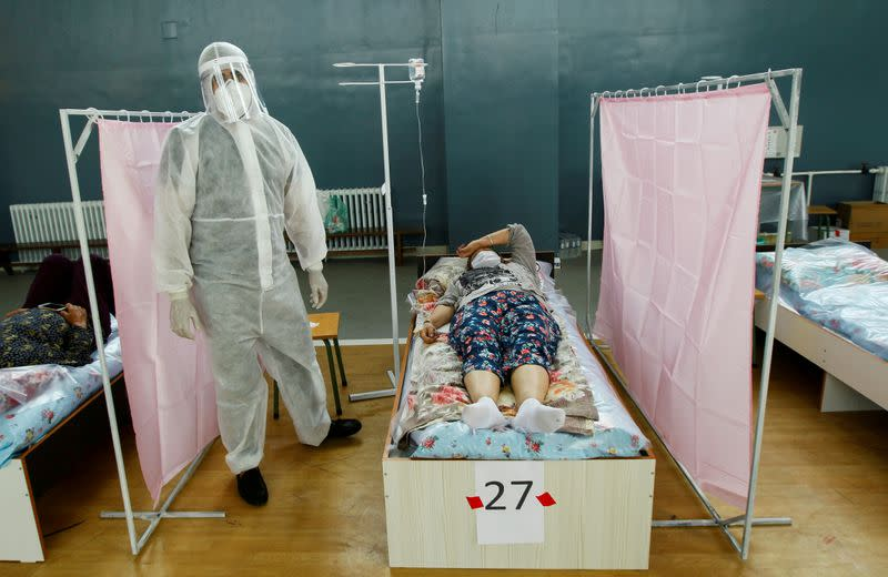 FILE PHOTO: Medical specialists treat patients at a day hospital amid the coronavirus disease (COVID-19) outbreak in Bishkek