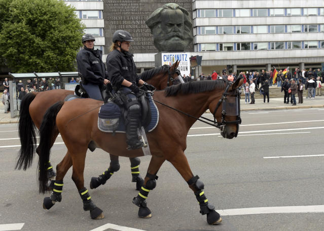 <p>Mounted police pass by the the Karl Marx statue as they are on patrol in Chemnitz, eastern Germany, Saturday, Sept. 1, 2018, after several nationalist groups called for marches protesting the killing of a German man last week, allegedly by migrants from Syria and Iraq. (Photo: Jens Meyer/AP) </p>
