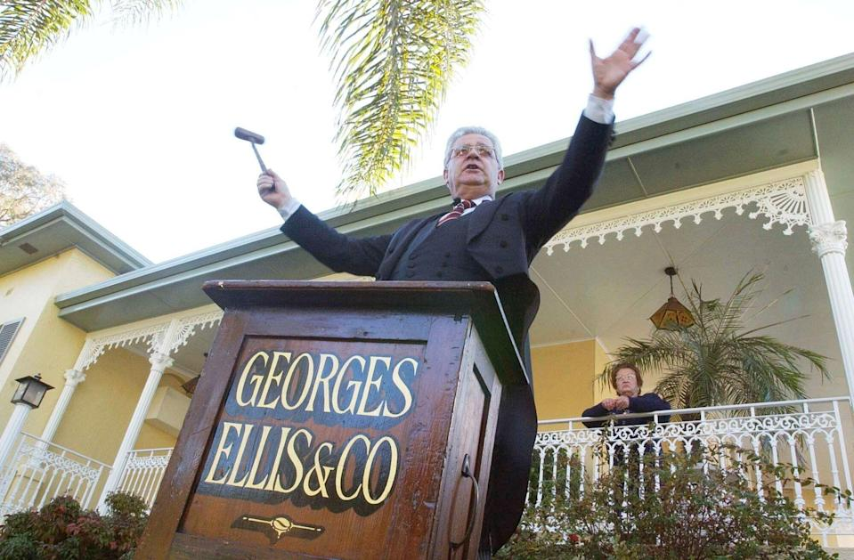 Sydney, August 02, 2003. Roger Ellis of real-estate agents Georges Ellis and Co, starts the bidding at an auction for the sale of a four-bedroom family residence in the Sydney suburb of Strathfield.  (AAP Image/Sam Mooy)