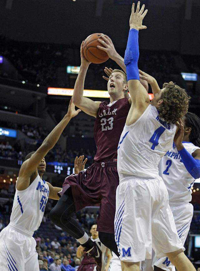 Arkansas-Little Rock forward Will Neighbour (23), of England, drives to the basket between Memphis guard Geron Johnson (55) and forward Austin Nichols (4) in the first half of an NCAA college basketball game on Friday, Dec. 13, 2013, in Memphis, Tenn. (AP Photo/Lance Murphey)