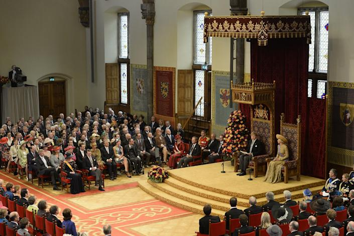 """Netherlands' King Willem-Alexander officially opens the new parliamentary year with a speech outlining the government's plan and budget policies for the year ahead, as his wife Queen Maxima, right, looks on in the 13th century """"Hall of Knights"""" in The Hague, Netherlands, Tuesday, Sept. 17, 2013. (AP Photo/Lex van Lieshout, Pool)"""