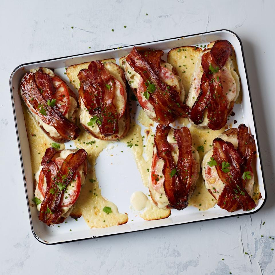 """<p>Star chef Bobby Flay smothers an open-face turkey sandwich with cheese sauce and bacon for his version of the over-the-top Louisville classic.</p><p><a href=""""https://www.foodandwine.com/recipes/kentucky-hot-brown"""">GO TO RECIPE</a></p>"""