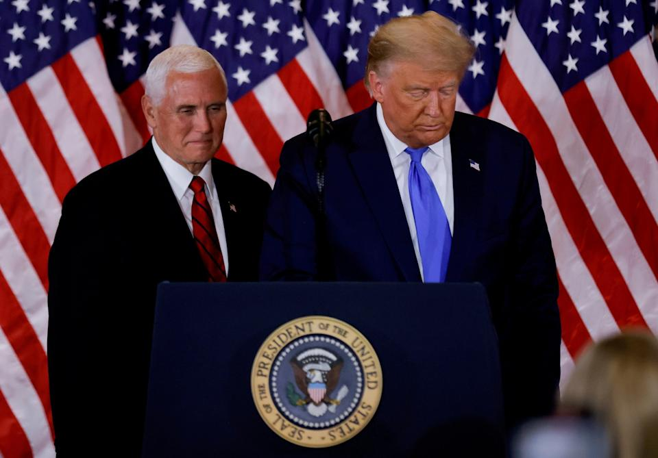 <p>File photo: US President Donald Trump and Vice President Mike Pence stand while making remarks about early results from the 2020 US presidential election</p> (REUTERS)
