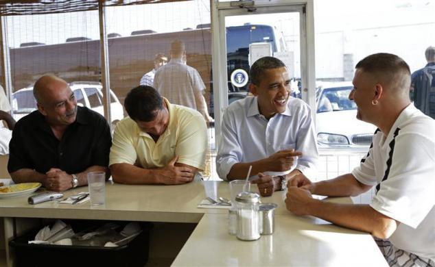 President Barack Obama (2nd R) talks to Keith Ross (R) as he sits down for breakfast at Ann's Place restaurant in Akron, Ohio July 6, 2012.